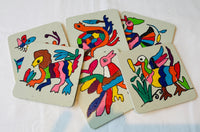 Set of 6 hand painted cork coasters with Otomi motifs.