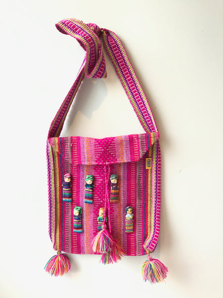 Handmade cross body bags from Oaxaca, Mexico with good luck dolls.