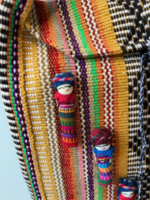 Handmade cross body bags from Oaxaca, Mexico with good lucky dolls.