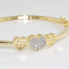 14k Gold Tone 3 Hearts Simulated Diamond Bangle