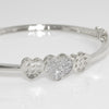 Silver Tone 3 Hearts Simulated Diamond Bangle