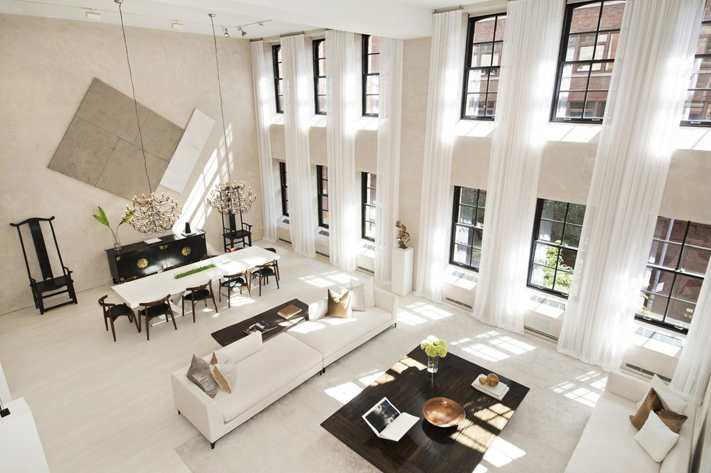 The main volume consists of a living area and a full dining room brass and silver details bring elegance to the streamlined decor staging