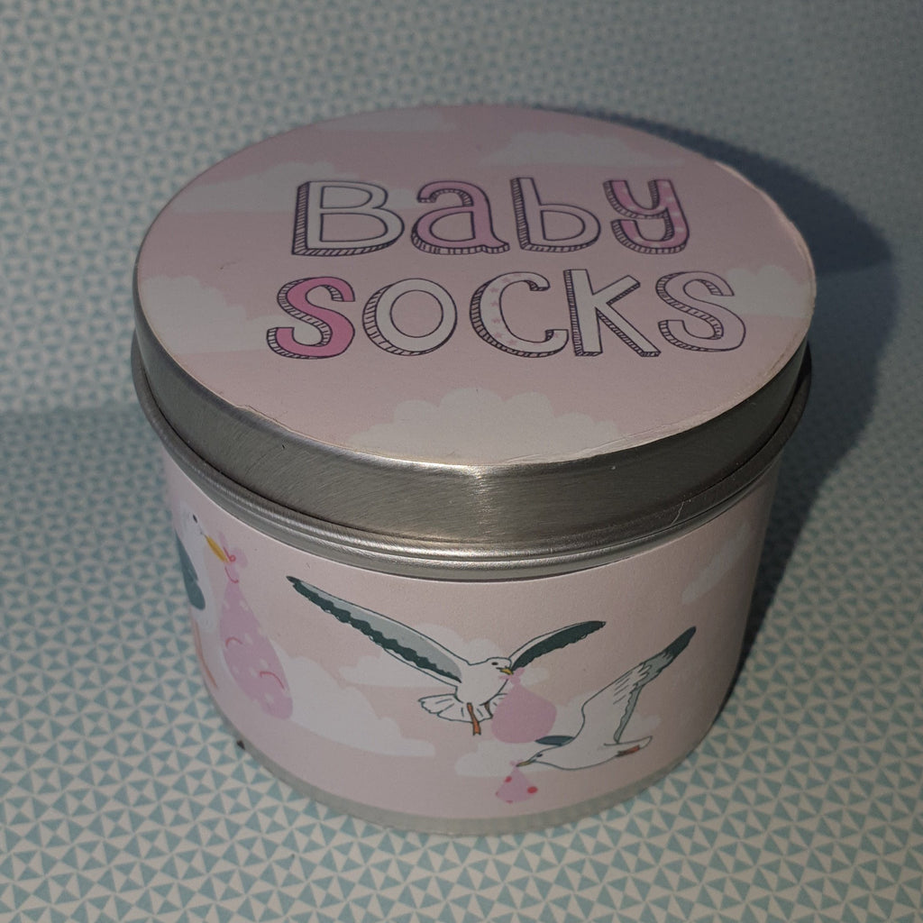 Little shrimp baby socks in a gift tin.