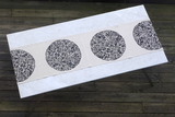 Dermond Peterson Black Mångata Table Runner on Natural Linen. Swedish. Moon. Black. Circle. Lunar Print. Made in Milwaukee.