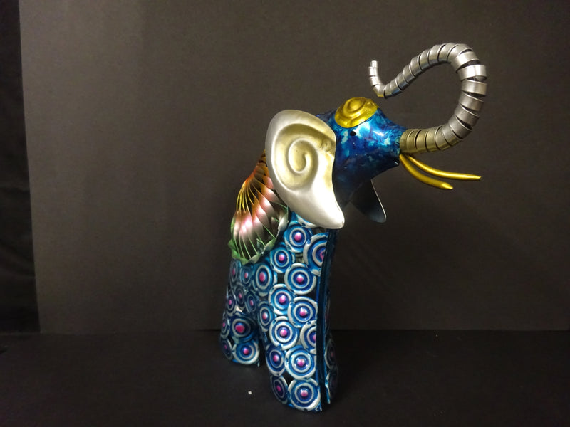 A hand painted metal Standing elephant figurine