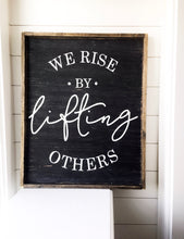 We Rise By Lifting Others- Wood Sign