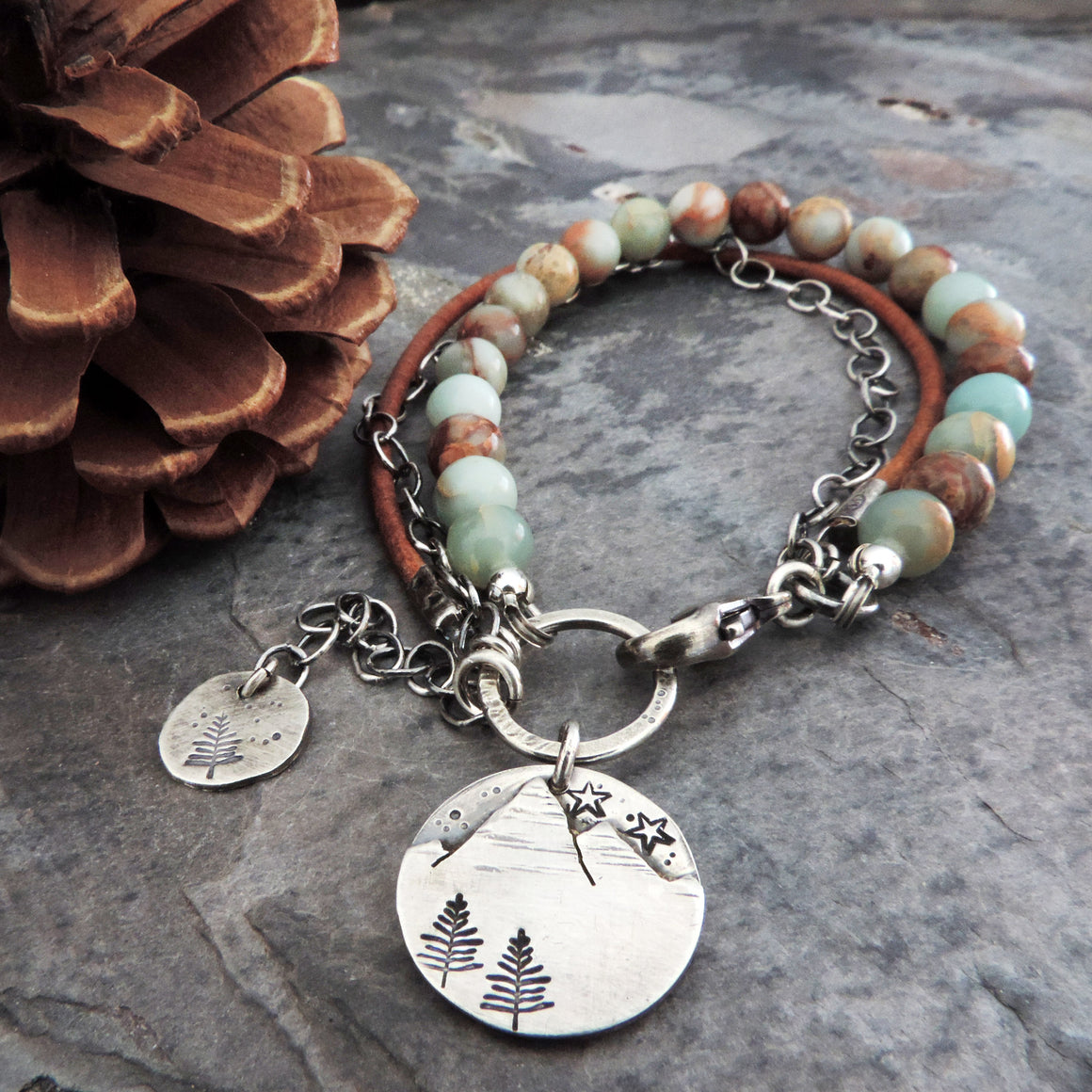 earthy beaded leather bracelet with silver mountain charm