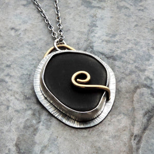contemporary silver black and gold pendant