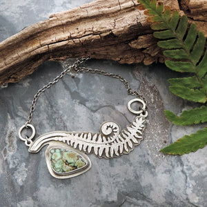 handmade unfurling fern in sterling silver
