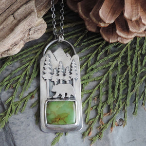 green turquoise pendant with bear in mountains