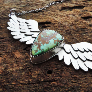 artisan angel wing pendant