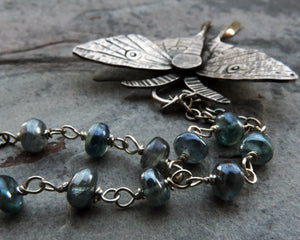 luna moth necklace with blue kyanite gemstones