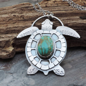 handmade sea turtle pendant with turquoise stone