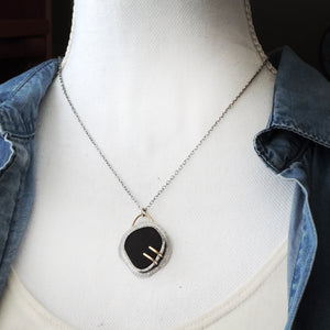 Black Sea Glass Pendant with Double Brass Prongs