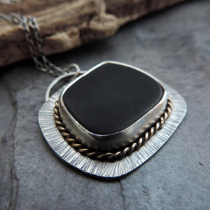silver black and gold jewelry