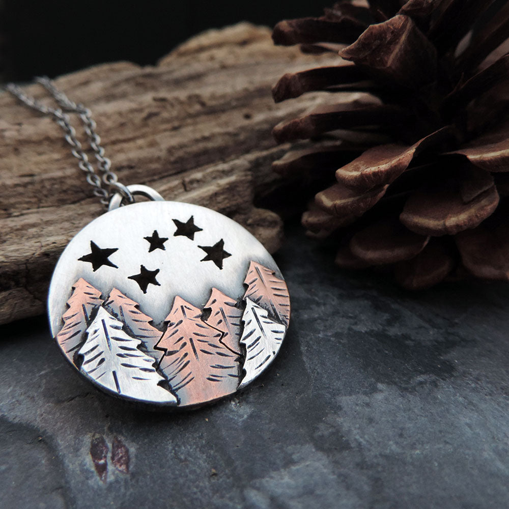 mixed metal pine trees and stars necklace