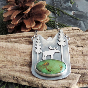 green turquoise pendant with moose in mountains