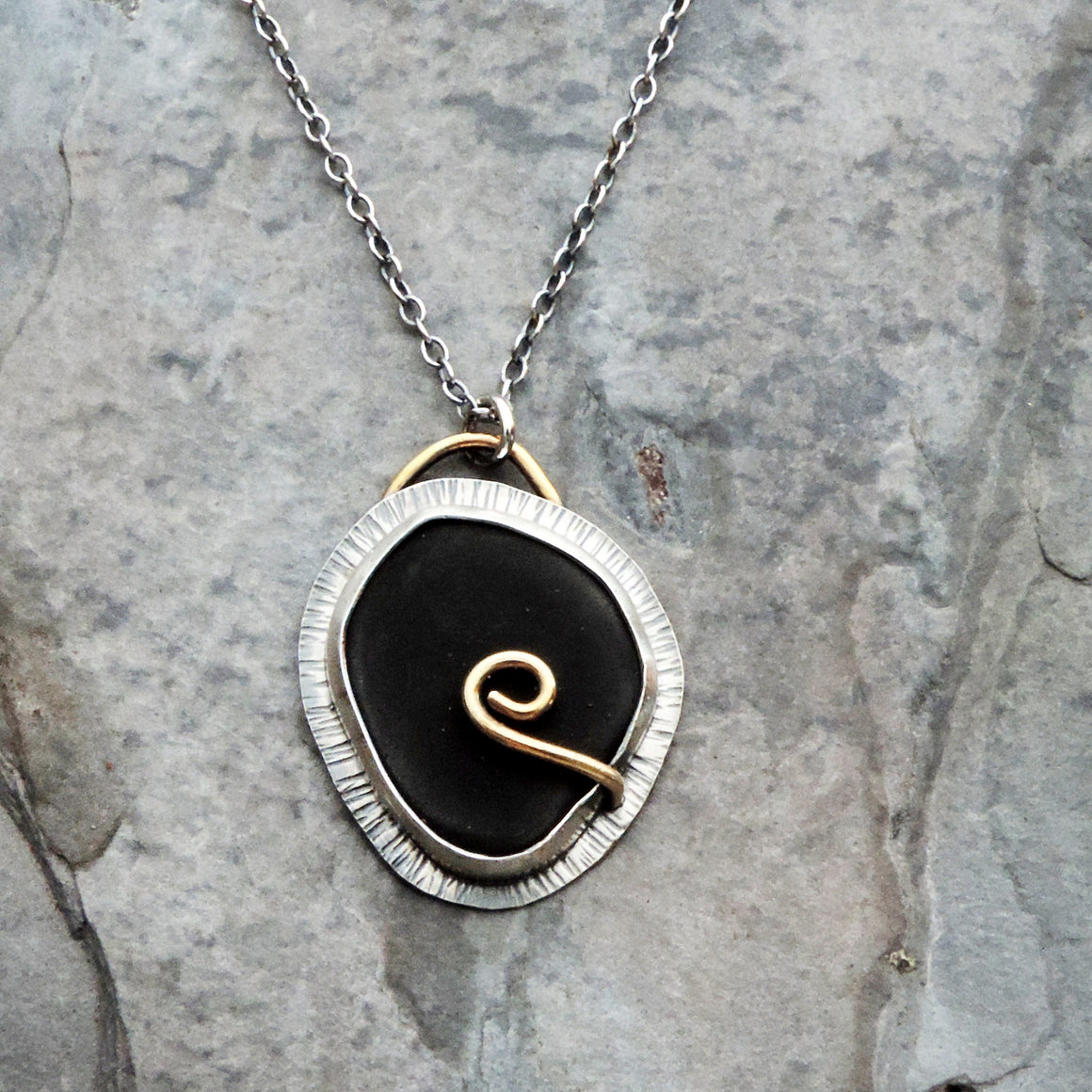 black silver and gold pendant necklace