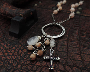 cross necklace with moonstone and sunstone