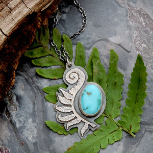 unfurling fern frond pendant with turquoise gemstone