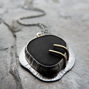 silver black and gold pendant necklace