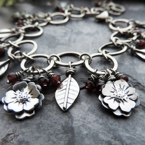 Flower Garden Charm Bracelet Accented with Red Garnet