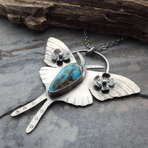 luna moth pendant with flowers and turquoise