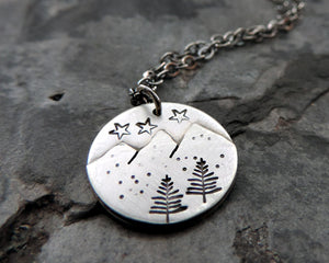 minimalist mountain necklace with stars and pine trees