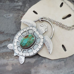 sea turtle necklace with turquoise gemstone