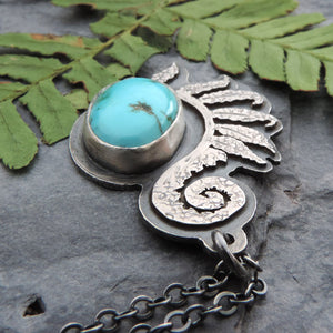 hand cut unfurling fern pendant