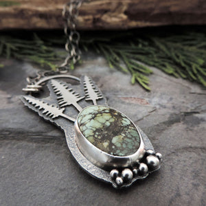 nature inspired jewelry with pine trees and gemstone