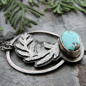 handmade silver fern pendant with turquoise stone