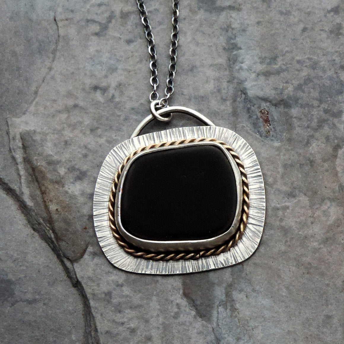 black beach stone sterling silver gold pendant