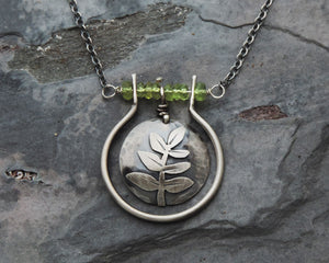 nature inspired silver botanical pendant