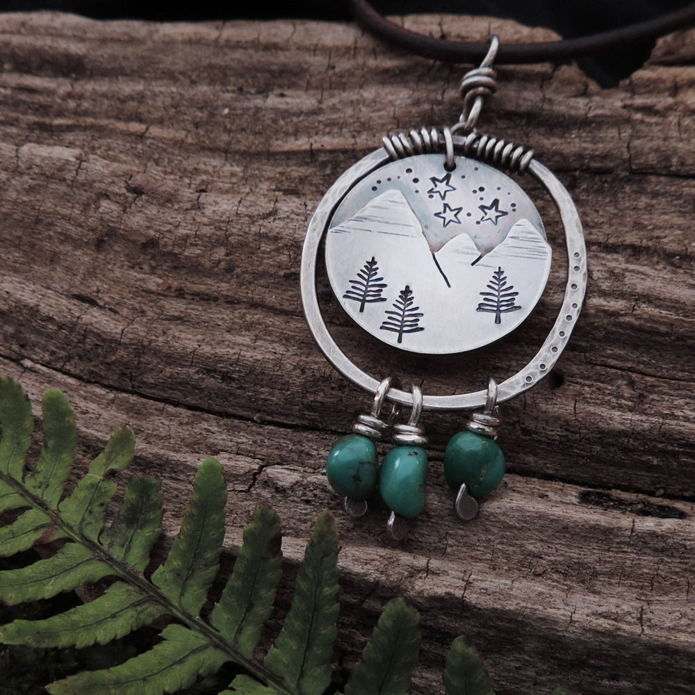 sterling silver mountain necklace with turquoise gemstones