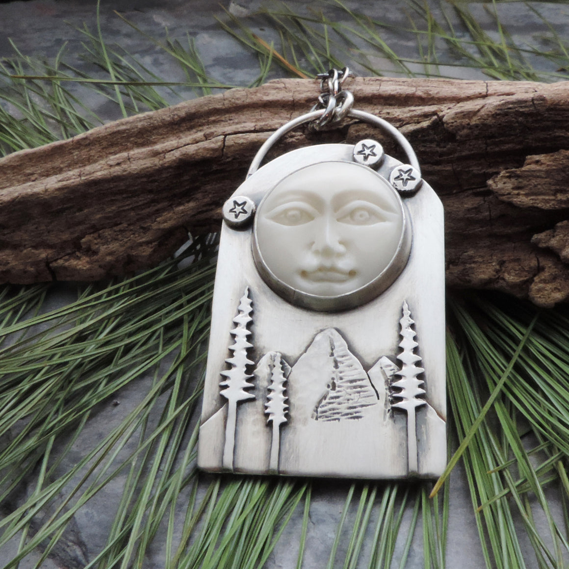 Moon Face Over Mountains and Pine Trees Necklace