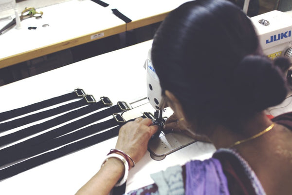 Sewing adjustable straps on to Lines & Current hold-all, hands-free FRIHET bag made by a lady in India