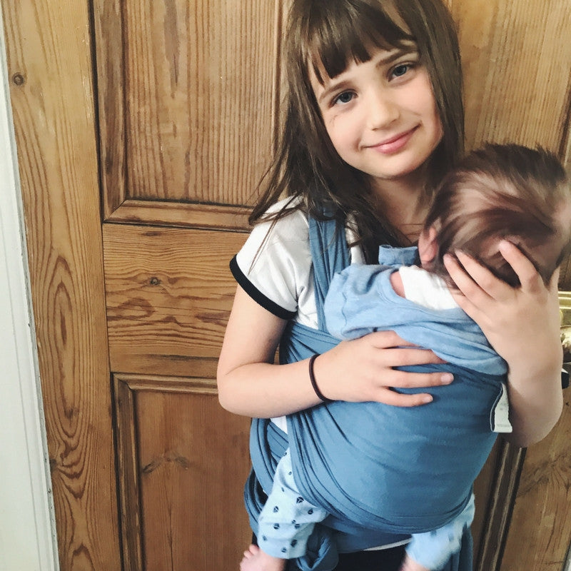 Esmee carrying her brother