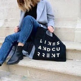 the FRIHET freedom 100% organic cotton fair trade bag in Belfast steps