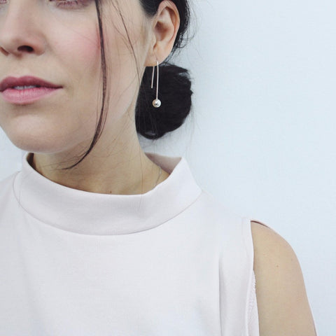 the PETRA Pendulum Drop Ball Earring