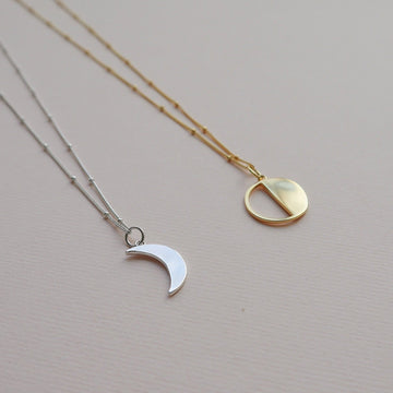 moon sister crescent and demi moon pendants