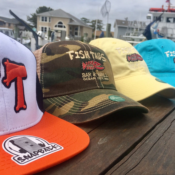 -Hats by Legacy - Fish Tales, Ocean City, MD's best waterfront restaurant and bar.  Coastal Apparel relaxed for the best of beach lovers.