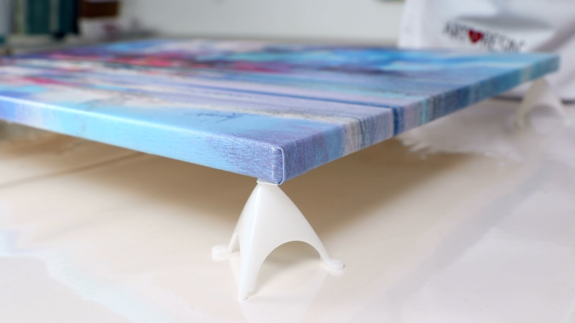 pyramid painters stands prop artwork up to resin