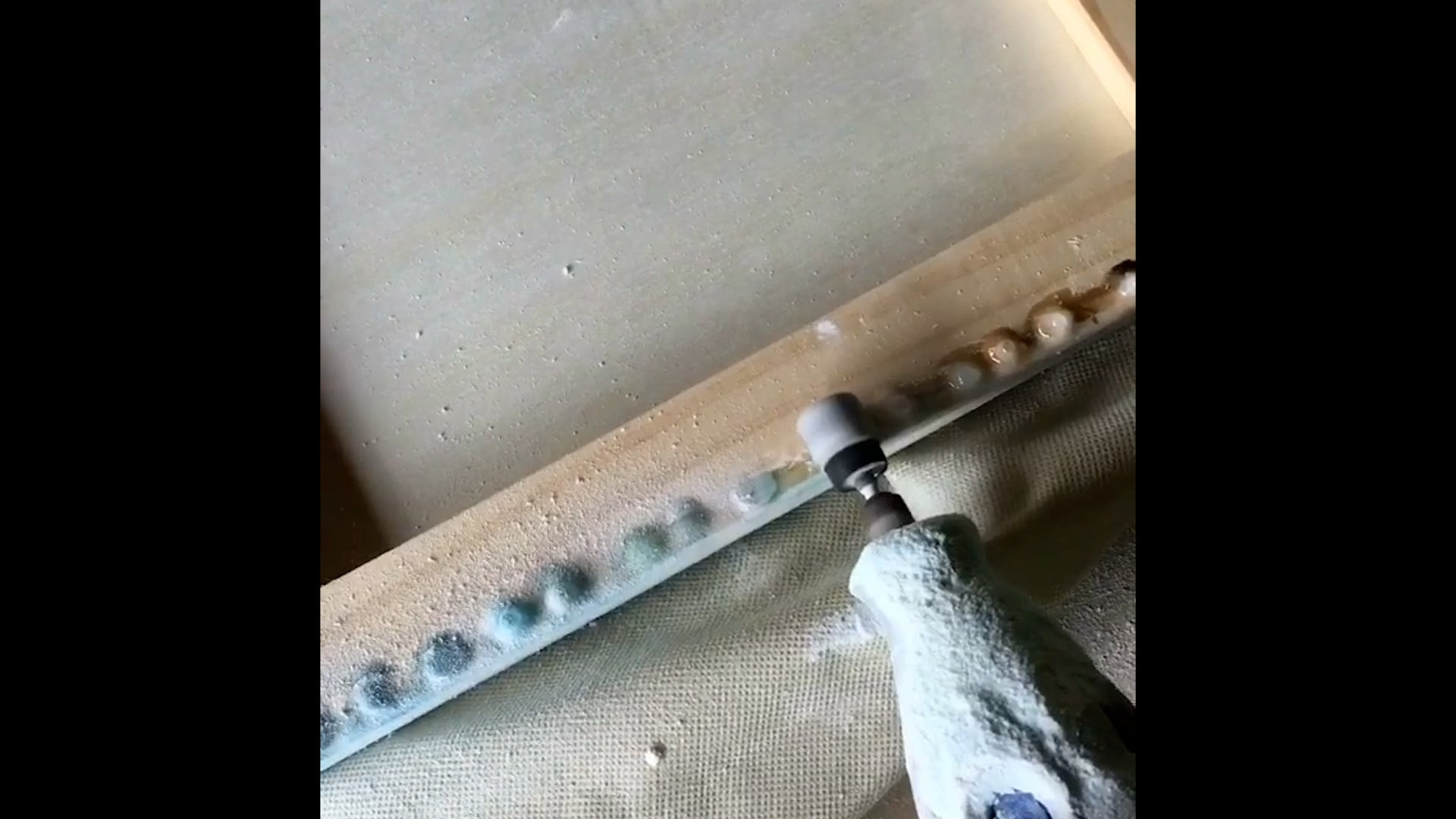 use a dremel to remove cured resin drips