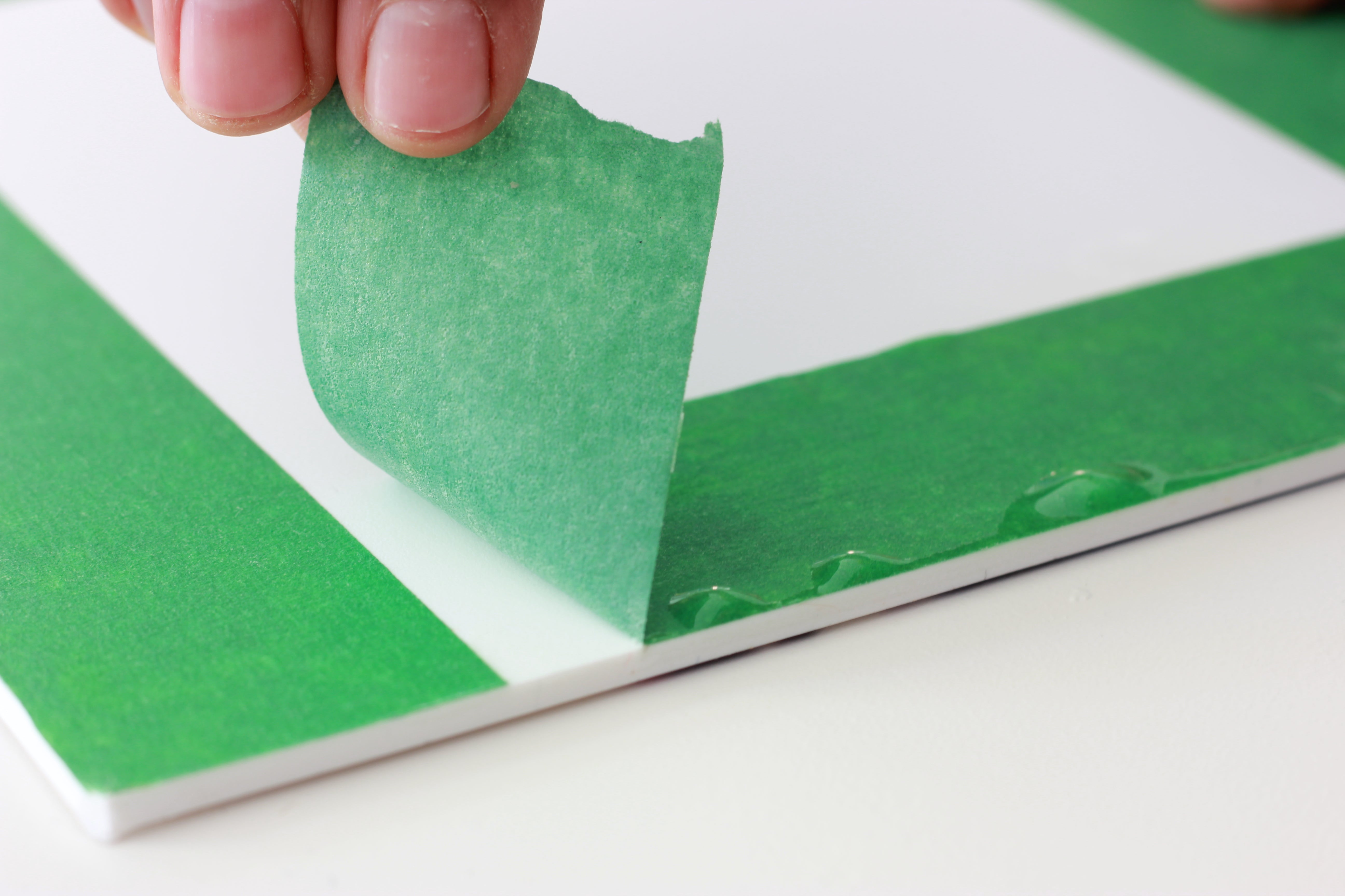 Pulling off tape with resin drips