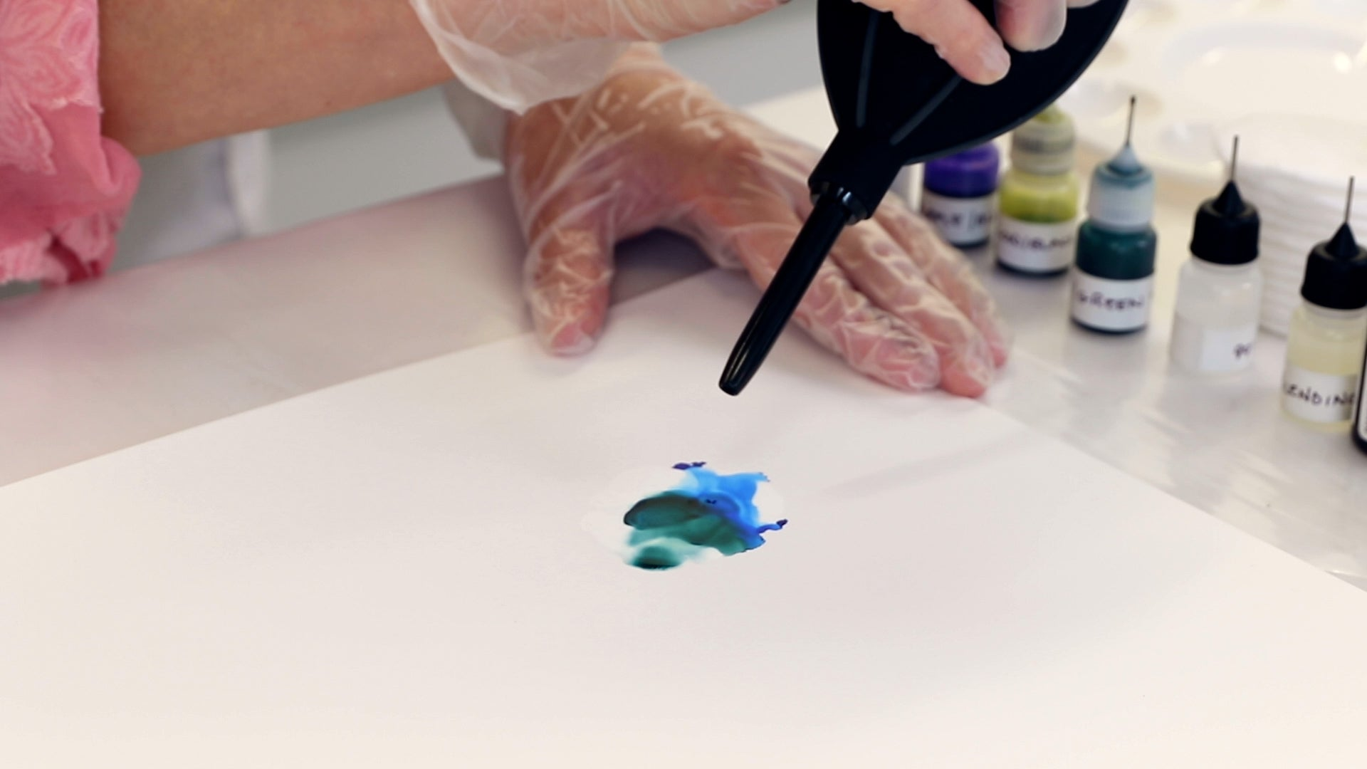 using a hand blower on alcohol ink on yupo paper