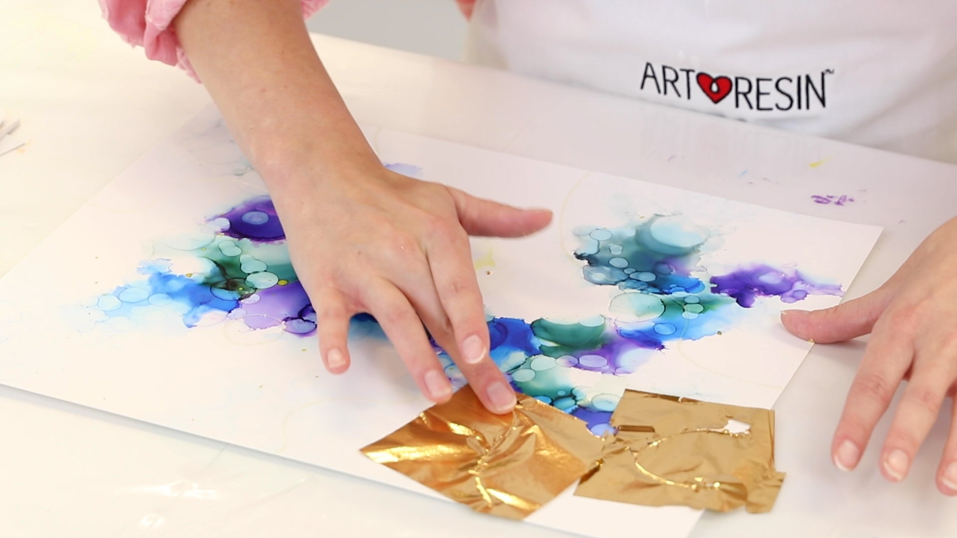 applying gold leaf to alcohol ink abstract painting