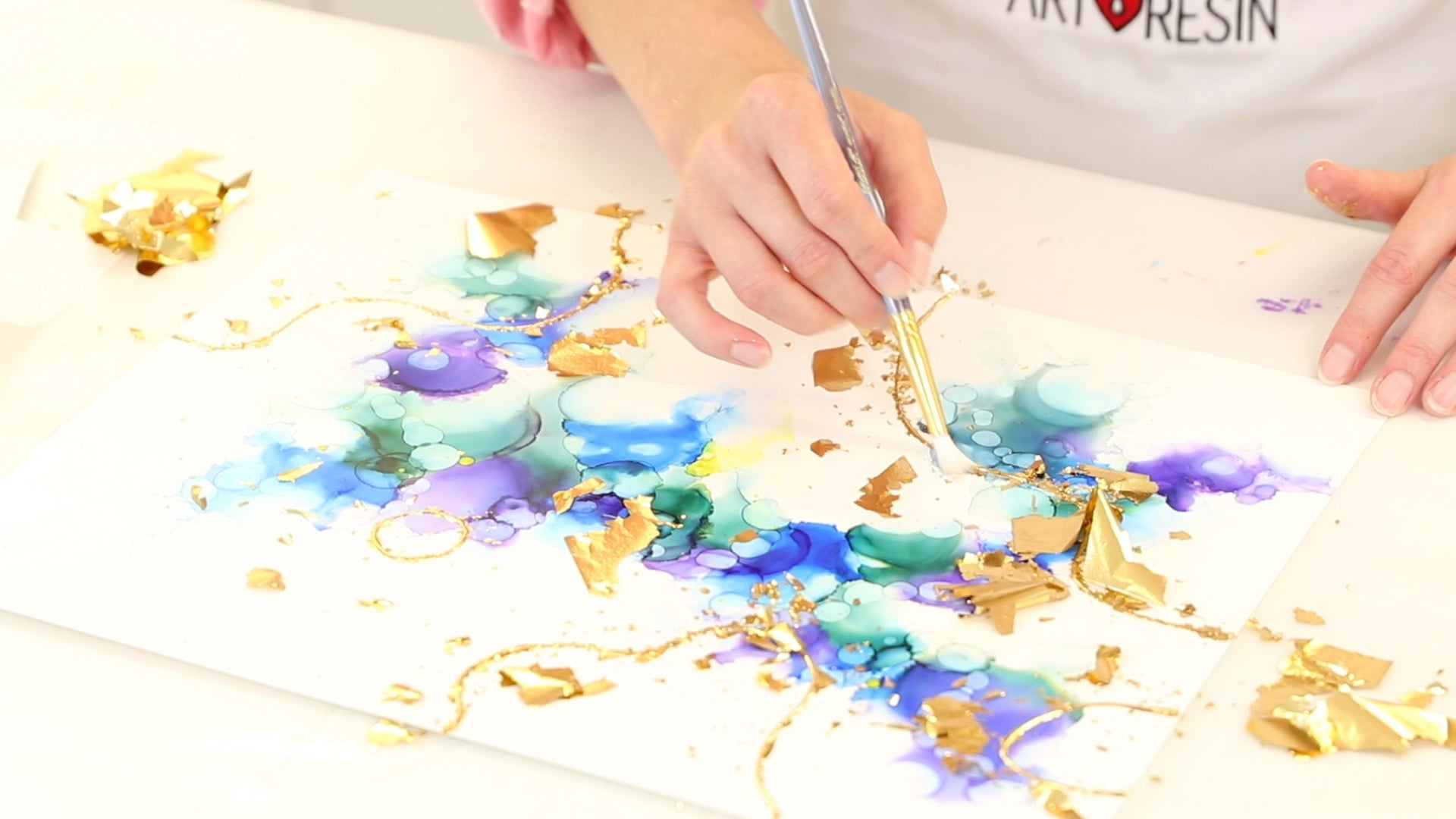 use mop brush to pull off excess gold leaf
