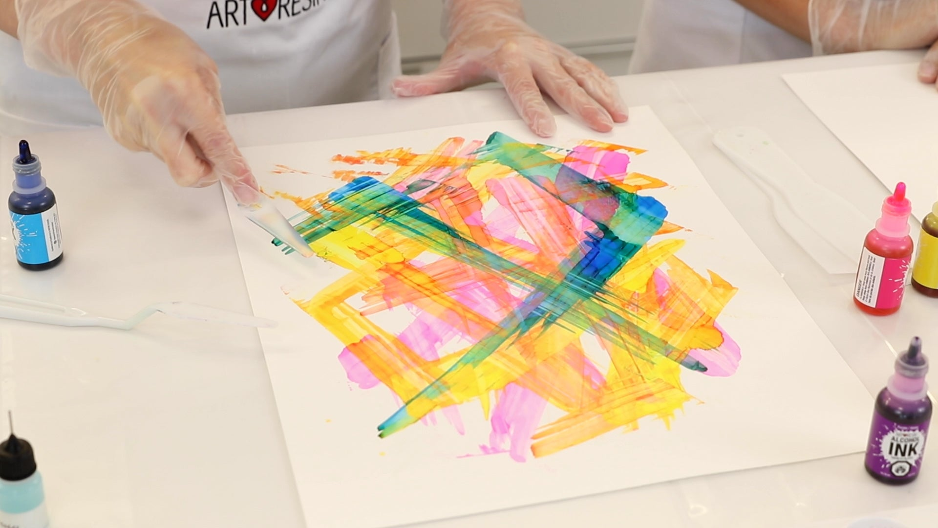 palette knife to apply alcohol ink to yupo paper