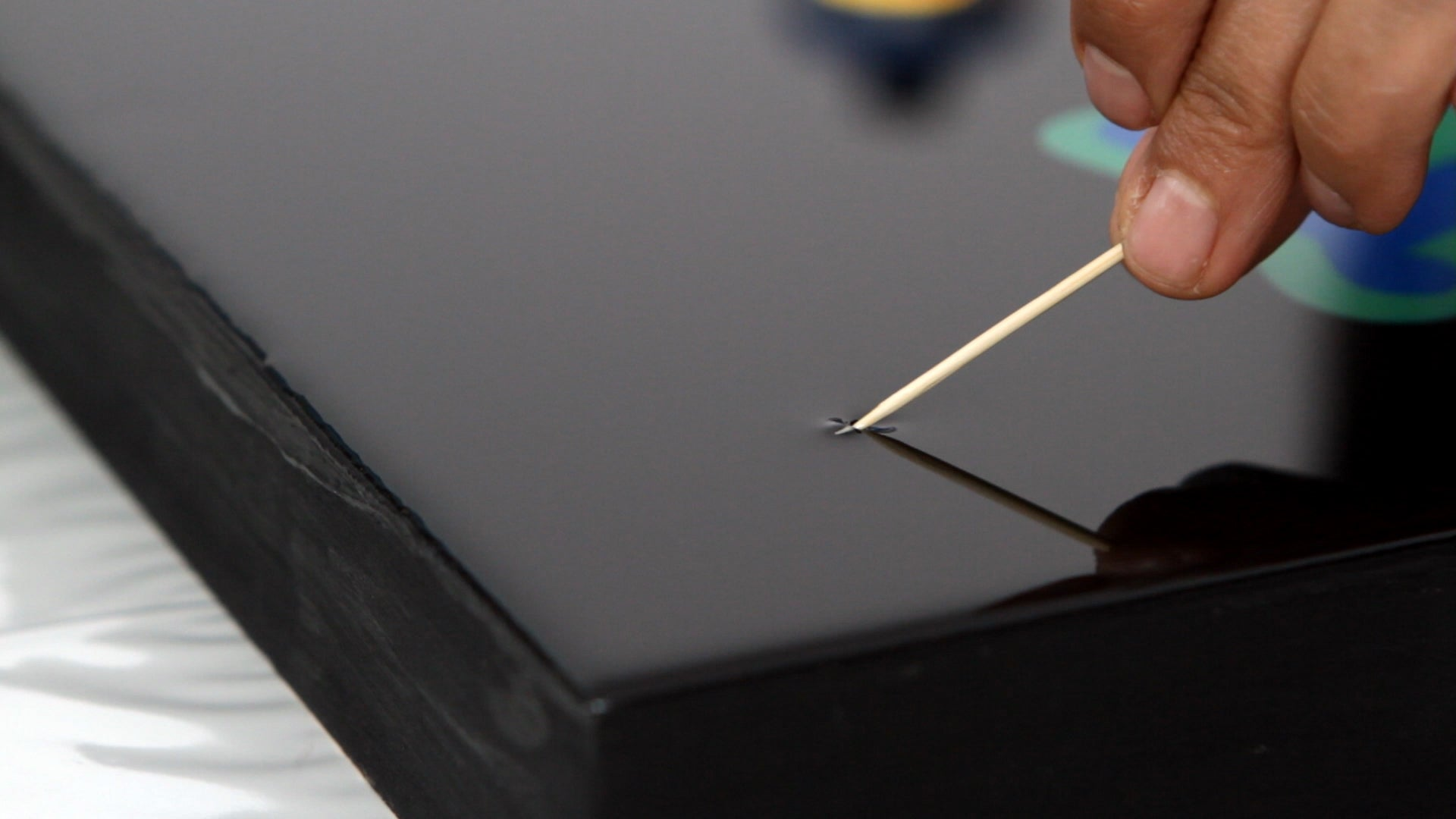 remove dust from resin with toothpick